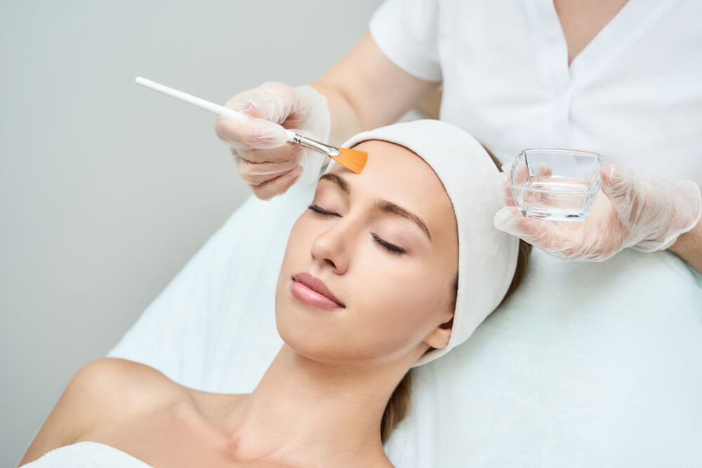 Aesthetician doing Chemical Peels on patients face