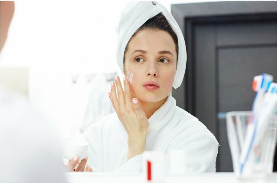woman preparing herself with skincare routine